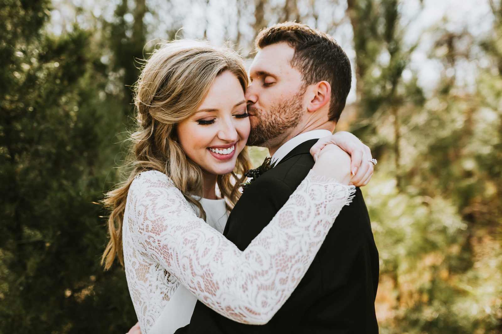 bride and groom hugging and smiling