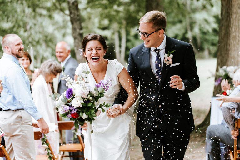bride and groom exit their wedding ceremony