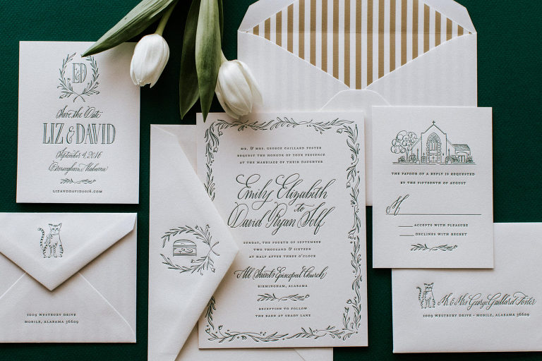 wedding invitation suite displayed neatly with tulips