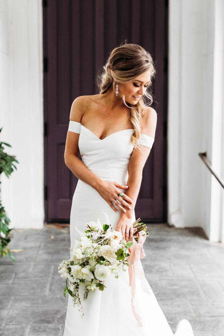 bride glances down at her wedding dress