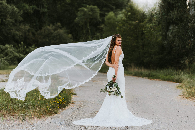 bride's veil blows in the wind