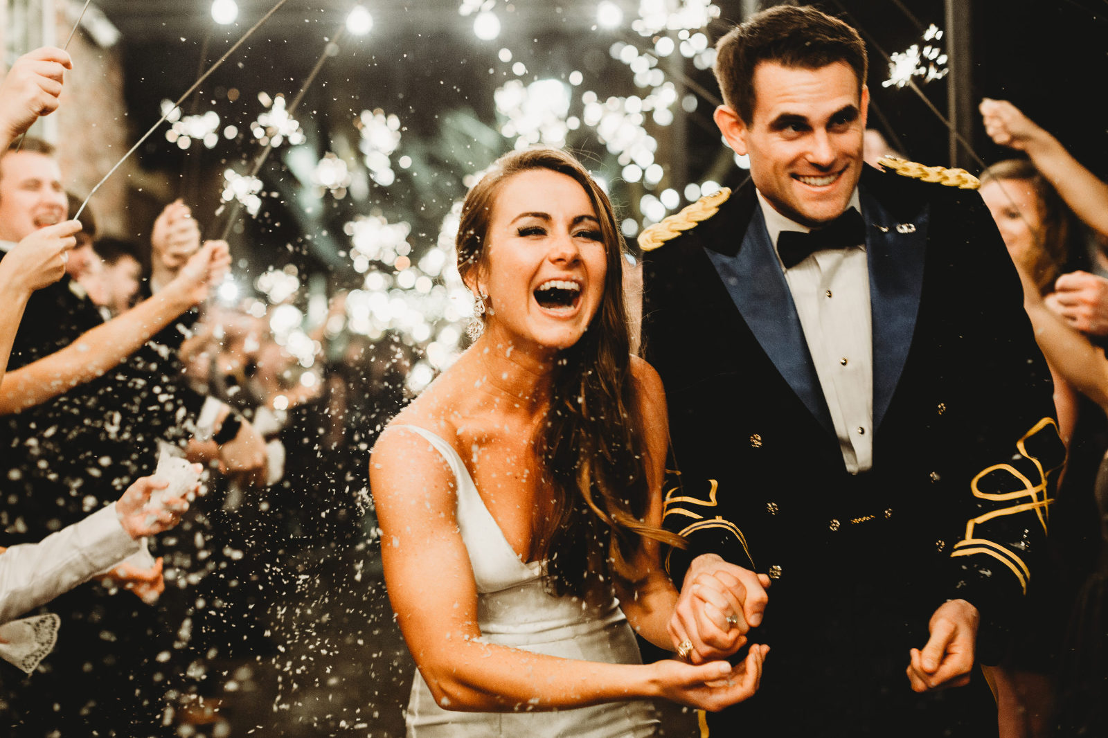 bride and groom run and laugh through their sparkler exit